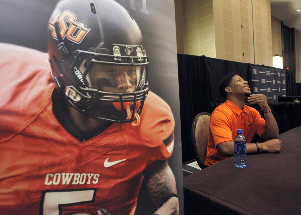 Oklahoma State wide receiver Josh Stewart ponders a question during the Big 12 Conference Football Media Days Monday, July 22, 2013 in Dallas.  (AP Photo/Tim Sharp)