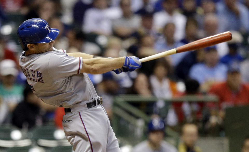 Photo - Texas Rangers' Ian Kinsler hits a double during the fourth inning of a baseball game against the Milwaukee Brewers on Wednesday, May 8, 2013, in Milwaukee. (AP Photo/Morry Gash)