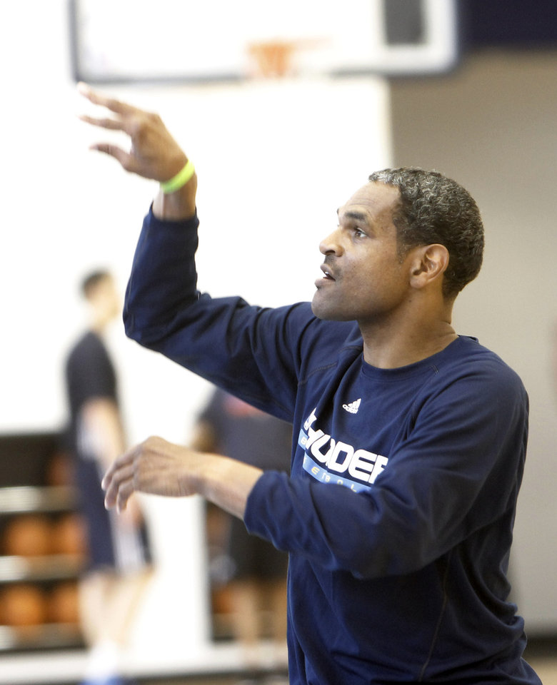Photo - Assistant coach Maurice Cheeks follows through after a free throw after the Thunder practice Sunday, June 10, 2012. Photo by Doug Hoke, The Oklahoman
