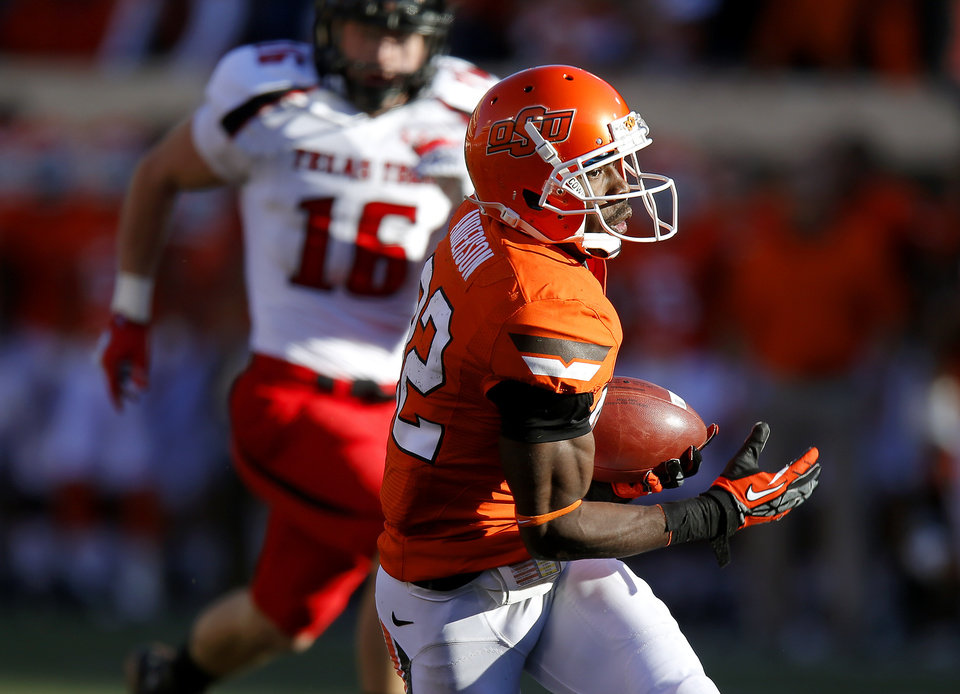 Photo - Oklahoma State's Isaiah Anderson (82) catches a touchdown pass during a college football game between Oklahoma State University (OSU) and Texas Tech University (TTU) at Boone Pickens Stadium in Stillwater, Okla., Saturday, Nov. 17, 2012.  Photo by Bryan Terry, The Oklahoman