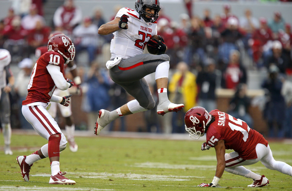 Texas Tech's Jace Amaro (22) leaps between Oklahoma's Quentin Hayes (10) and Zack Sanchez (15) during a college football game between the University of Oklahoma Sooners (OU) and the Texas Tech Red Raiders at Gaylord Family-Oklahoma Memorial Stadium in Norman, Okla., on Saturday, Oct. 26, 2013. Photo by Bryan Terry, The Oklahoman