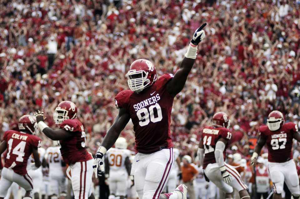 Oklahoma defensive end David King celebrates after Oklahoma recovered a fumble against Texas during the first half of an NCAA college football game at the Cotton Bowl Saturday, Oct. 13, 2012, in Dallas. (AP Photo/The Daily Texan, Lawrence Peart)