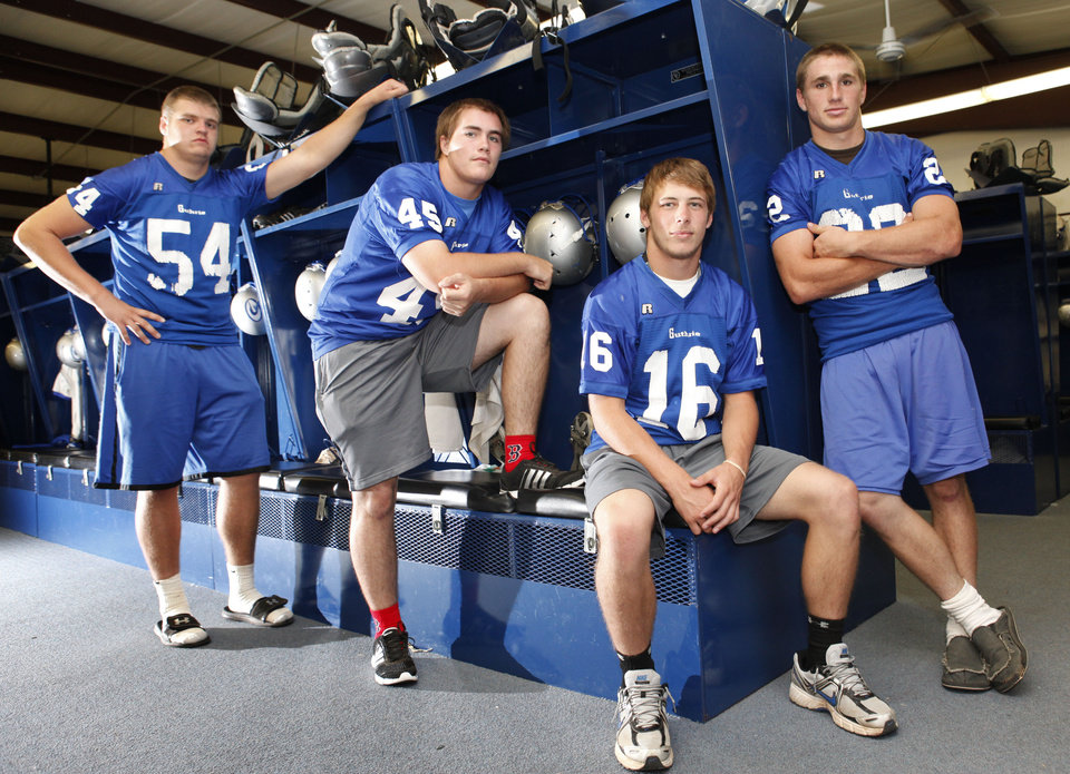 L-R: Guthrie High School football players Blake Belcher, Landry Chappell, Bryan Dutton, and Luke Davis pose in the locker room at Guthrie High School in Guthrie, OK, Thursday, July 7, 2011. By Paul Hellstern, The Oklahoman ORG XMIT: KOD