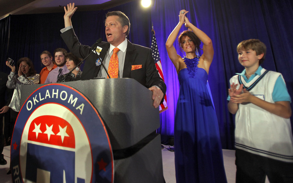 Photo - Labor Commissioner elect Mark Costello is surrounded by family as he waves to supporters in his win over Lloyd Fields at the republican Watch Party at the Marriott on Tuesday, Nov. 2, 2010, in Oklahoma City, Okla.   Photo by Chris Landsberger, The Oklahoman
