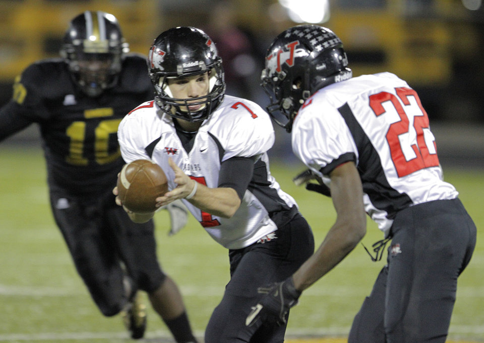 Photo - Westmoore's Trevor Thompson (7) hands the ball off to Austin Richards (22) during a high school football game between Midwest City and Westmoore in Midwest City, Friday, Nov. 11, 2011.  Photo by Garett Fisbeck, for The Oklahoman