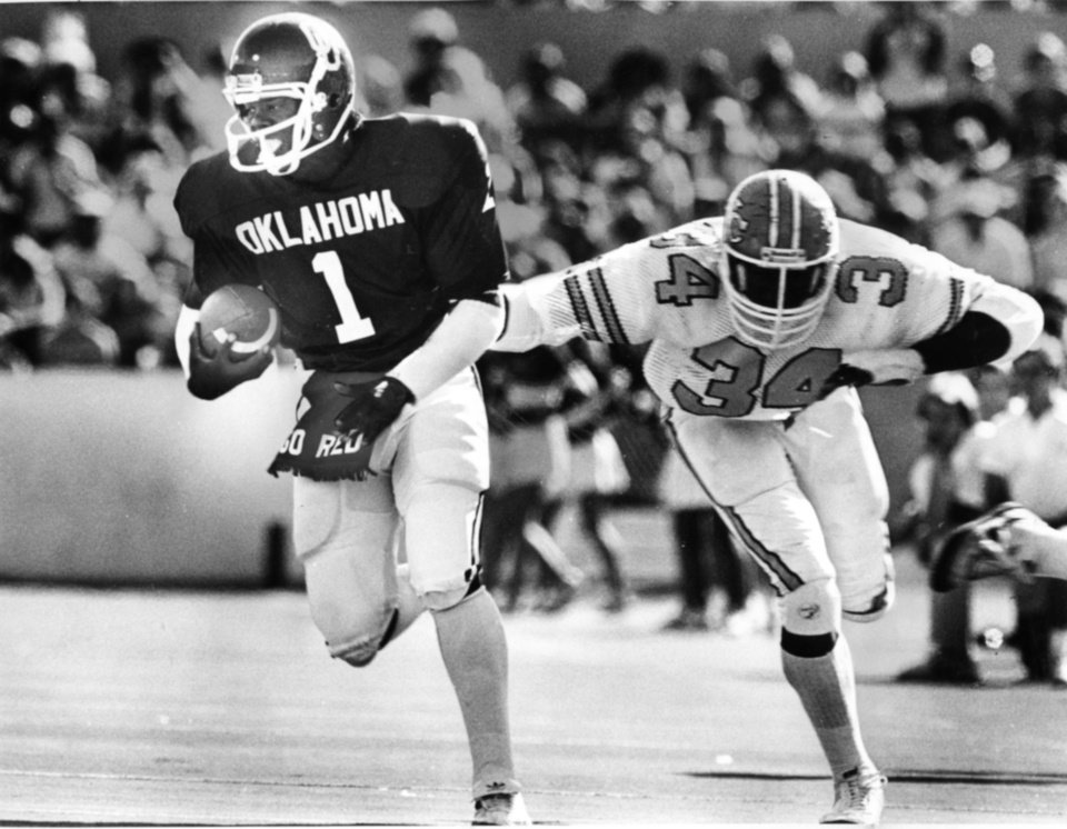 "Photo - FOOTBALL OU UNIVERSITY OF OKLAHOMA 1980: Caption reads ""OU quarterback J.C. Watts eludes a final would-be tackler to complete his first-quarter, 42-yard touchdown run Saturday."" Photo taken by Doug Hoke. Photo taken 10-31-1980. Photo was published in The Daily Oklahoman 11-2-1980."