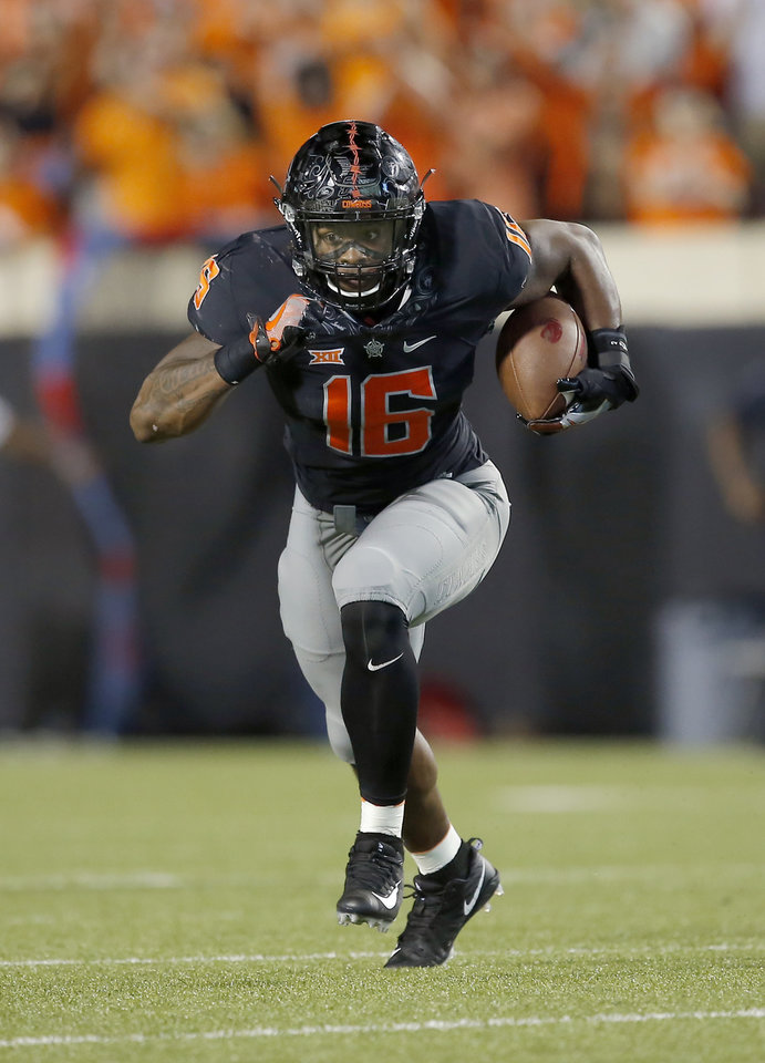 Photo - Oklahoma State's Devin Harper (16) runs in for a touchdown after intercepting a throw intended for South Alabama's Sam Harris (4) during a college football game between Oklahoma State (OSU) and South Alabama at Boone Pickens Stadium in Stillwater, Okla., Saturday, Sept. 8, 2018. Photo by Sarah Phipps, The Oklahoman