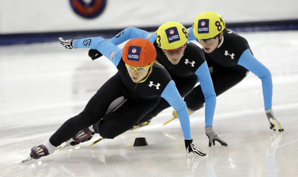 Photo - Jessica Smith, left, Emily Scott, center and Alyson Dudek compete in the women's 1,500 meters during the U.S. Olympic short track speedskating trials Friday, Jan. 3, 2014, in Kearns, Utah. (AP Photo/Rick Bowmer)