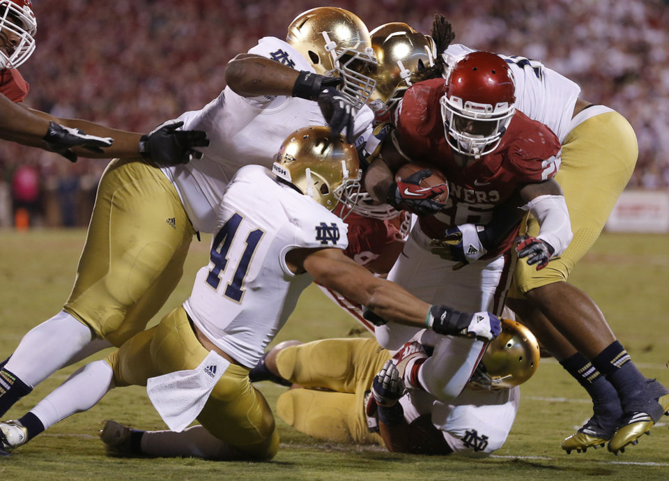 OU's Damien Williams (26) is brought down short of the goal line by Notre Dame's Matthias Farley (41), and Louis Nix III (9), top left,  during the college football game between the University of Oklahoma Sooners (OU) and the Notre Dame Fighting Irish at Gaylord Family-Oklahoma Memorial Stadium in Norman, Okla., Saturday, Oct. 27, 2012. Oklahoma lost 30-13. Photo by Bryan Terry, The Oklahoman