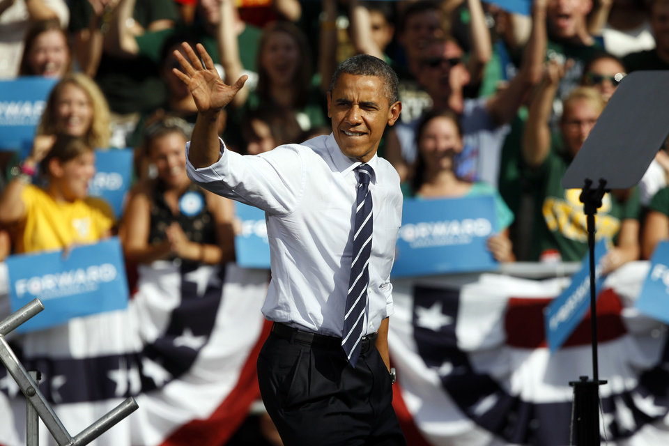 Photo -   President Barack Obama waves as he takes the stage during campaign stop on the campus of Colorado State University in Fort Collins, Colo., on Tuesday, Aug. 28, 2012. (AP Photo/David Zalubowski)