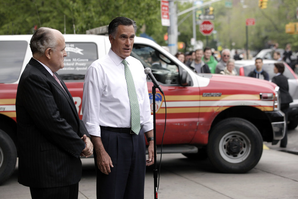 Photo -   Republican presidential candidate, former Massachusetts Gov. Mitt Romney, accompanied by former New York City Mayor Rudy Giuliani, talks to reporters in front of Engine 24, Ladder 5 in New York, Tuesday, May 1, 2012. (AP Photo/Jae C. Hong)