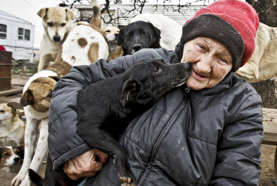 Catherine Titus gives and receives love from her dogs on Monday, Feb. 22, 2010, in Wilson, Okla.  Photo by Chris Landsberger, The Oklahoman