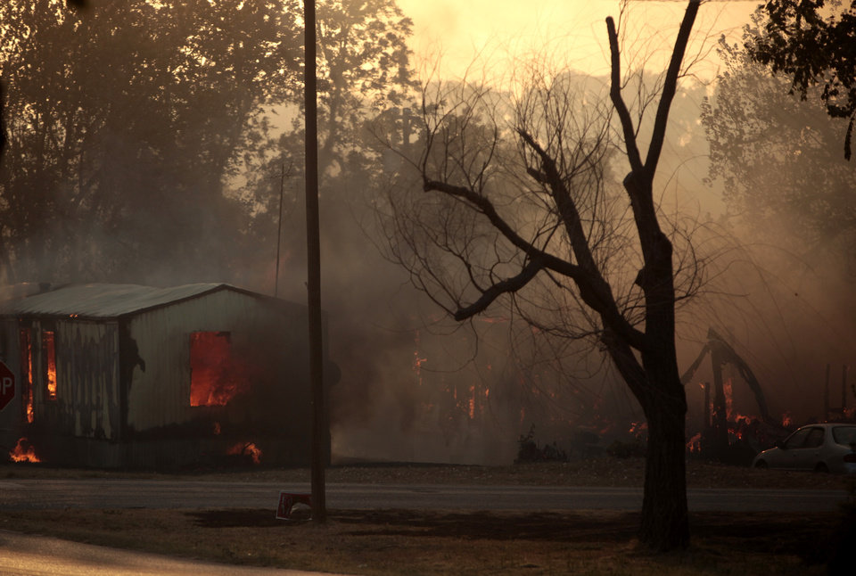 Photo - A home burns in Luther, Okla.,  during a large wildfire Friday, Aug. 3, 2012. Photo by Sarah Phipps, The Oklahoman