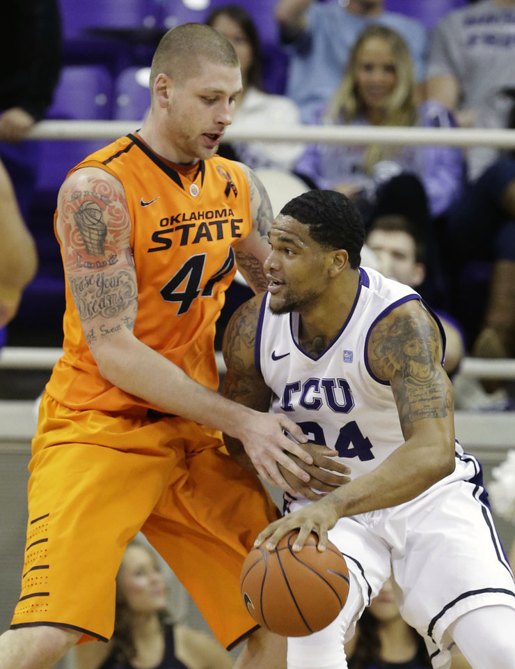 Oklahoma State's Philip Jurick (44) defends as TCU 's Adrick McKinney (24) looks for an opening to the basket in the first half of an NCAA basketball game on Wednesday, Feb. 27, 2013, in Fort Worth, Texas. (AP Photo/Tony Gutierrez) ORG XMIT: TXTG104