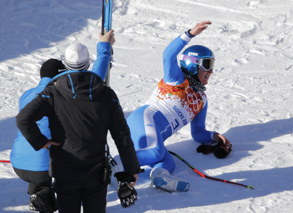 Photo - Italy's Daniela Merighetti lies on the snow after finishing a women's downhill training run at the Sochi 2014 Winter Olympics, Thursday, Feb. 6, 2014, in Krasnaya Polyana, Russia.   (AP Photo/Christophe Ena)