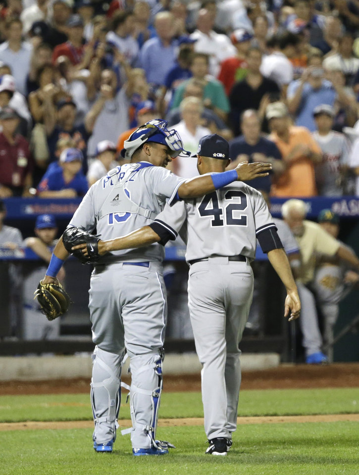 Photo - American League's Mariano Rivera, of the New York Yankees, is congratulated by catcher Salvador Perez, left, of the Kansas City Royals, after the eighth inning of the MLB All-Star baseball game, on Tuesday, July 16, 2013, in New York. (AP Photo/Matt Slocum)