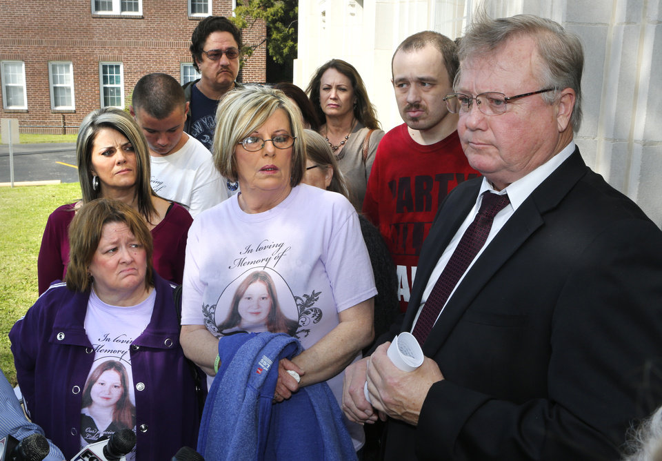 Photo -  Okfuskee County District Attorney Max Cook, right, told reporters Friday murderer Kevin Sweat slashed one of his defense attorneys inside the courthouse before his sentencing Friday. At left is Patricia Taylor, mother of murder victim Ashley Taylor, and aunt Regenia Carter, wearing T-shirts with Ashley's photo.     David McDaniel -  The Oklahoman