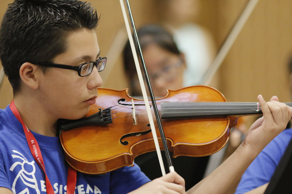 Photo -  Diego Cifuentes performs as part of El Sistema Oklahoma during the youth orchestra's last concert of the school year at St. Luke's United Methodist Church, 222 NW 15.Photo by Doug Hoke, The Oklahoman   DOUG HOKE -