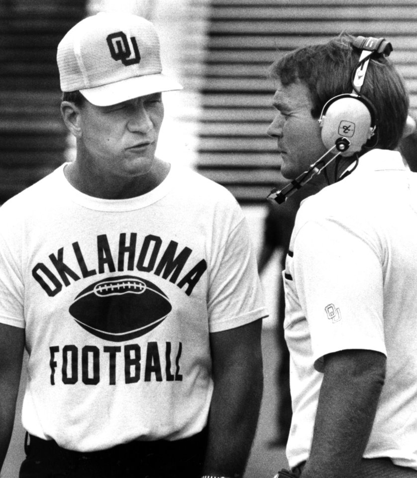 "<strong>Happy Birthday wish from Merv Johnson, OU director of football operations: </strong><br> <i>""(Happy Birthday to) someone who gave me the opportunity to come back and work with a longtime friend here at the University of Oklahoma. Little did I realize how much I would appreciate and enjoy being here in Oklahoma for all of these 30-plus years."" </i><br> <br />  <strong>1985: Switzer and Merv</strong><br>  In this 1985 photo, Switzer and Merv Johnson discuss play during a scrimmage in September 1985. Johnson spent 20 years as an OU assistant coach, helping the Sooners to a national championship, five Big Eight Conference titles and seven bowl game victories. PHOTO BY GEORGE R. WILSON, The Oklahoman Archives"