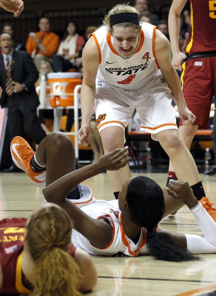 Photo - Oklahoma State's Liz Donohoe (4) celebrates with Toni Young (15) during the women's college basketball game between Oklahoma State and Iowa State at  Gallagher-Iba Arena in Stillwater, Okla.,  Sunday,Jan. 20, 2013.  OSU won 71-42. Photo by Sarah Phipps, The Oklahoman