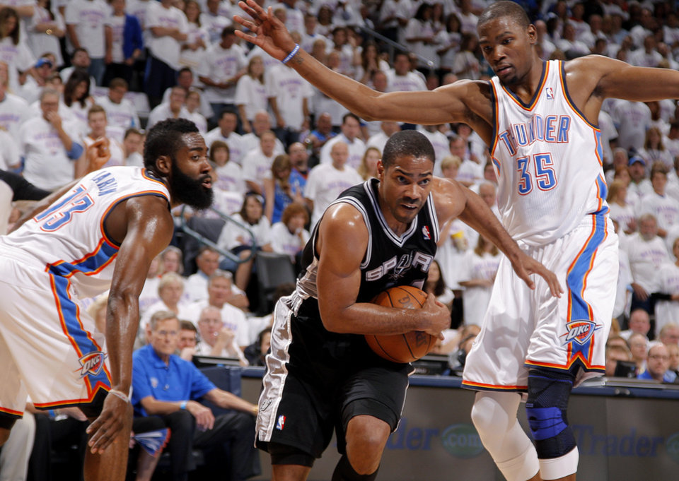 San Antonio's Gary Neal (14) goes between Oklahoma City's James Harden (13) and Kevin Durant (35) during Game 6 of the Western Conference Finals between the Oklahoma City Thunder and the San Antonio Spurs in the NBA playoffs at the Chesapeake Energy Arena in Oklahoma City, Wednesday, June 6, 2012. Photo by Bryan Terry, The Oklahoman