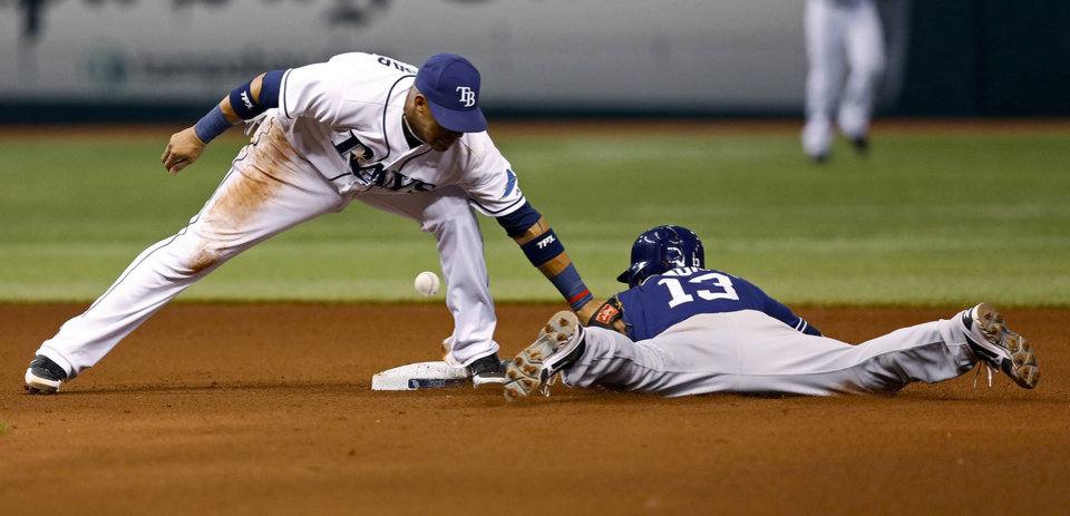 Photo - San Diego Padres' Chris Denorfia, right, slides in safely with a steal of second base as Tampa Bay Rays shortstop Yunel Escobar cannot hold on to the throw during the fourth inning of an interleague baseball game, Friday, May 10, 2013, in St. Petersburg, Fla. (AP Photo/Mike Carlson)