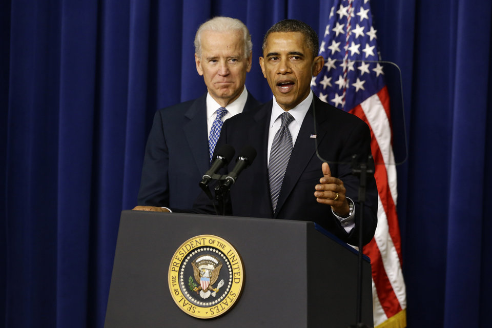 President Barack Obama, accompanied by Vice President  Joe Biden, talks about proposals to reduce gun violence, Wednesday, Jan. 16, 2013, in the South Court Auditorium at the White House in Washington. (AP Photo/Charles Dharapak) ORG XMIT: WHCD102