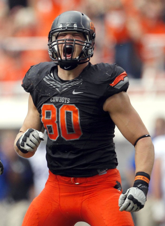 Oklahoma State's Cooper Bassett (80) celebrates a play during the first half of the college football game between the Oklahoma State University Cowboys (OSU) and the University of Kansas Jayhawks (KU) at Boone Pickens Stadium in Stillwater, Okla., Saturday, Oct. 8, 2011. Photo by Sarah Phipps, The Oklahoman