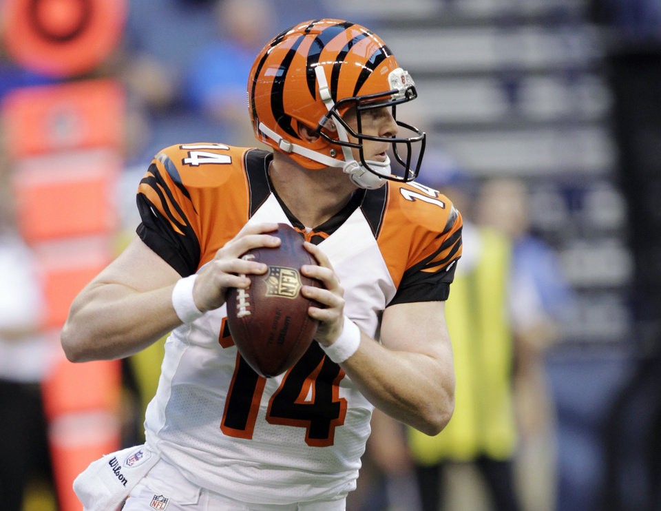 Photo -   Cincinnati Bengals quarterback Andy Dalton looks to throw against the Indianapolis Colts in the first half of an NFL preseason football game in Indianapolis, Thursday, Aug. 30, 2012. (AP Photo/AJ Mast)