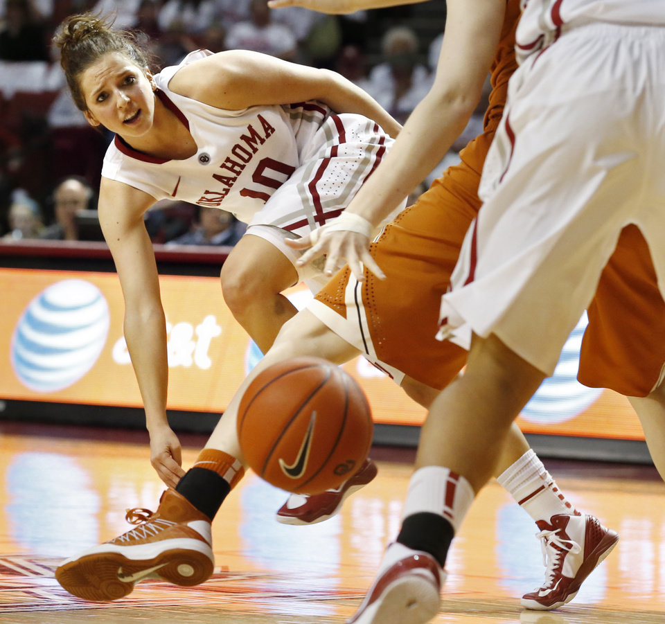 Photo - Oklahoma Sooners' Morgan Hook (10) passes in the second half as the University of Oklahoma Sooners (OU) defeat the University of Texas (UT) Longhorns 69-56 in NCAA, women's college basketball at The Lloyd Noble Center on Saturday, Jan. 19, 2013 in Norman, Okla. Photo by Steve Sisney, The Oklahoman