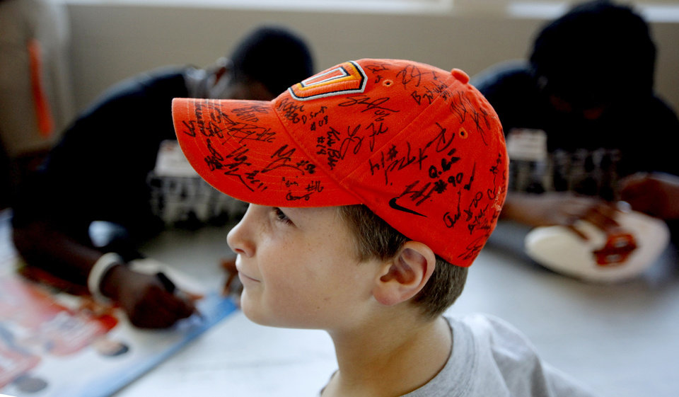 Photo - OKLAHOMA STATE UNIVERSITY / OSU / COLLEGE FOOTBALL / CHILDREN / KIDS: Sam West, 9, of Piedmont, waits for an autograph during OSU Fan Appreciation Day 2009 for the Oklahoma State football team inside Gallagher-Iba Arena in Stillwater, Okla., Saturday, August 8, 2009. Photo by Bryan Terry, The Oklahoman ORG XMIT: KOD