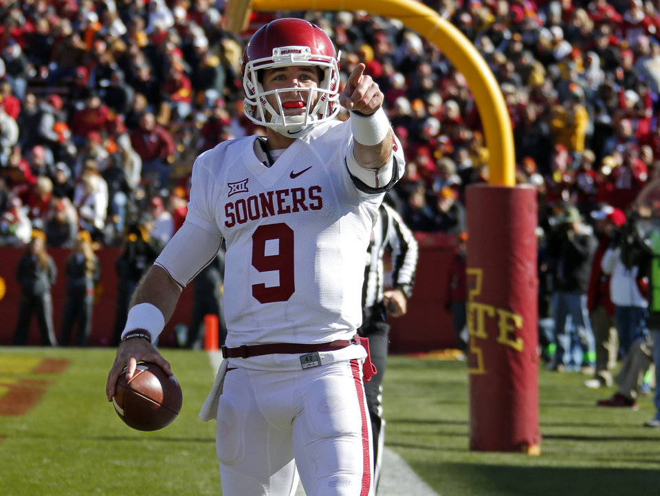 Photo - Oklahoma's Trevor Knight (9) celebrates after a touchdown during a college football game between the University of Oklahoma Sooners (OU) and the Iowa State Cyclones (ISU) at Jack Trice Stadium in Ames, Iowa, Saturday, Nov. 1, 2014. Photo by Bryan Terry, The Oklahoman
