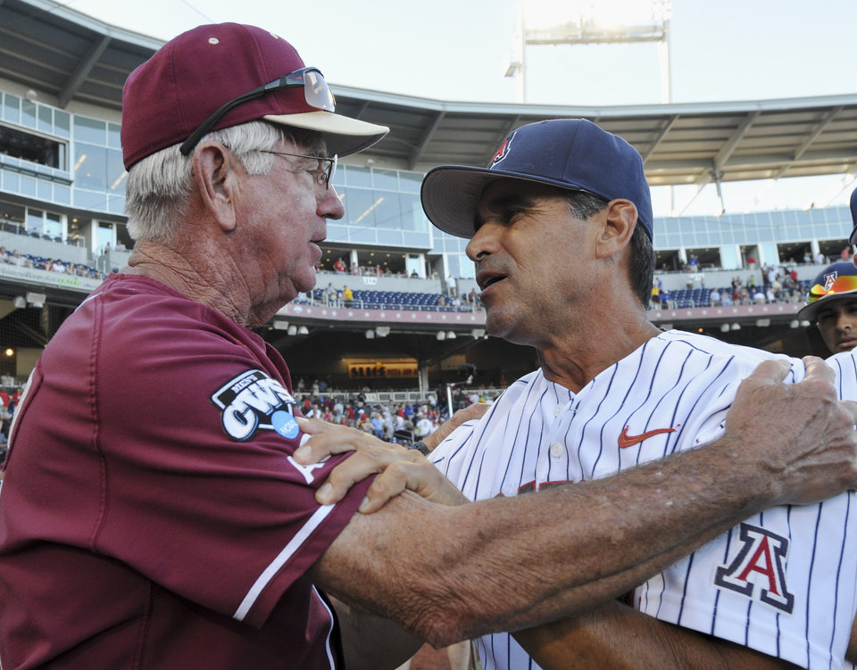 Photo -   Florida State coach Mike Martin, left, and Arizona coach Andy Lopez exchange words following an NCAA College World Series baseball game in Omaha, Neb., Thursday, June 21, 2012. Arizona defeated Florida State 10-3. (AP Photo/Dave Weaver)