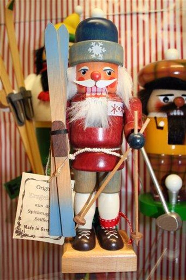 "This Nov. 11, 2012 photo shows a variety of Nutcracker dolls at The Whitney Shop In New Canaan, Conn. The wooden dolls, many of which will really crack your walnuts and macadamias, are increasingly popular in holiday decor. The classic Nutcracker nutcracker, a soldier with his sword in hand and prominent moustache, comes from the early 19th-century tale ""The Nutcracker and the Mouse King."" (AP Photo/Samantha Critchell)"