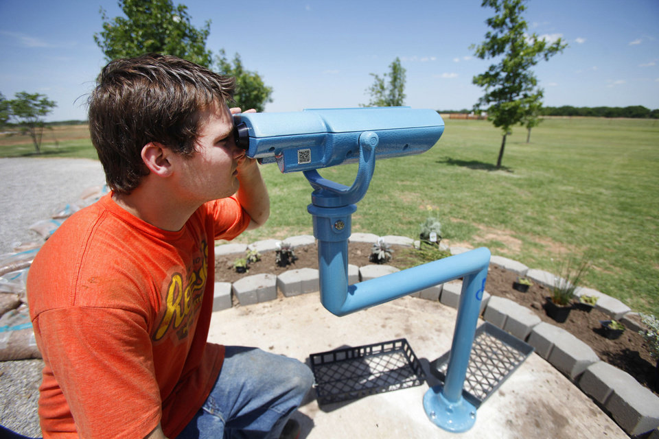 Photo - Cody La Fever uses a telescope to watch prairie dogs in the wheelchair-accessible garden at Canadian Valley Technology Center in El Reno. Photos By Steve Gooch, The Oklahoman