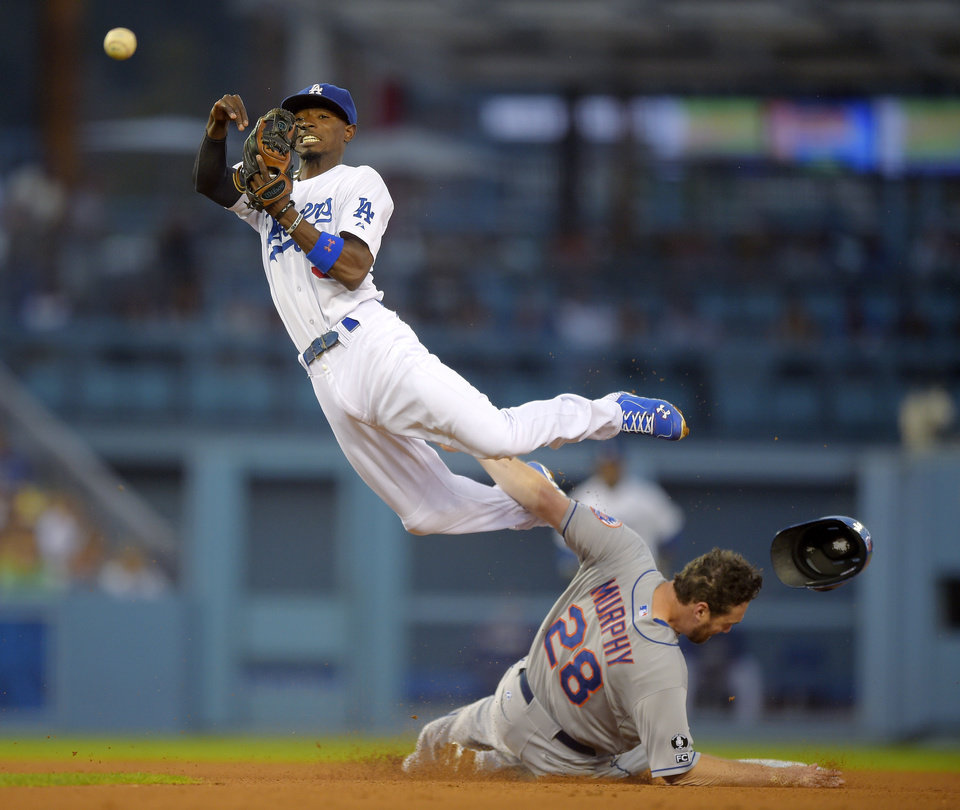 Photo - New York Mets' Daniel Murphy, below, is forced out at second as Los Angeles Dodgers second baseman Dee Gordon throws out David Wright at first during the fifth inning of a baseball game, Saturday, Aug. 23, 2014, in Los Angeles. (AP Photo/Mark J. Terrill)