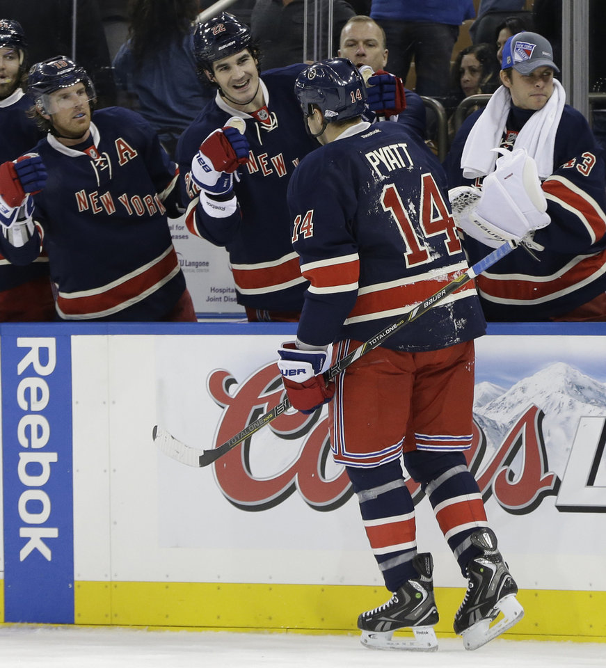 Photo - New York Rangers centers Brad Richards (19) and Brian Boyle (22) greet Taylor Pyatt after Pyatt scored a goal in the second period of their NHL hockey game against the Boston Bruins at Madison Square Garden in New York, Wednesday, Jan. 23, 2013.  (AP Photo/Kathy Willens)