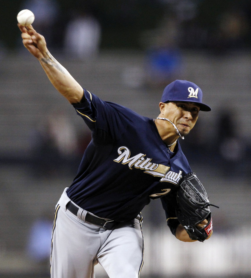Milwaukee Brewers starting pitcher Kyle Lohse delivers against the San Diego Padres in the first inning of a baseball game, Monday, April 22, 2013, in San Diego. (AP Photo/Alex Gallardo)
