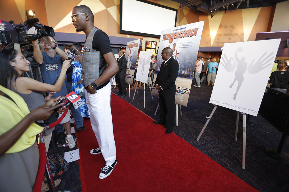 The Oklahoma City Thunder's Kevin Durant, answers questions during the red carpet premiere of Thunderstruck at Harkins Bricktown Theatre in Oklahoma City, Sunday, Aug. 19, 2012.  Photo by Garett Fisbeck, For The Oklahoman