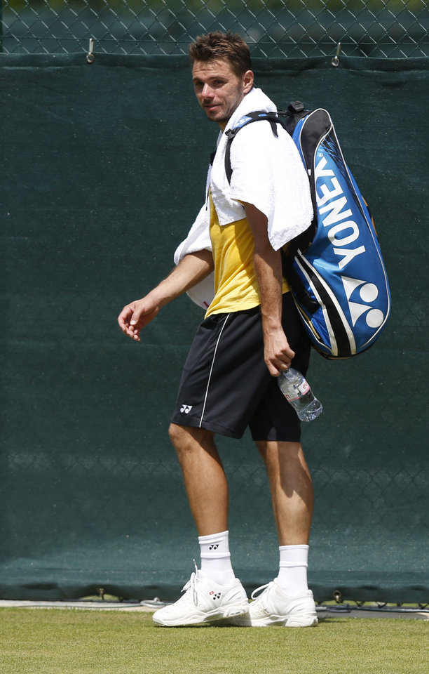 Photo - Stan Wawrinka of Switzerland arrives for a practice session ahead of the All England Lawn Tennis Championships in Wimbledon, London, Sunday June 22, 2014. The Championships start on Monday June 23. (AP Photo/Sang Tan)