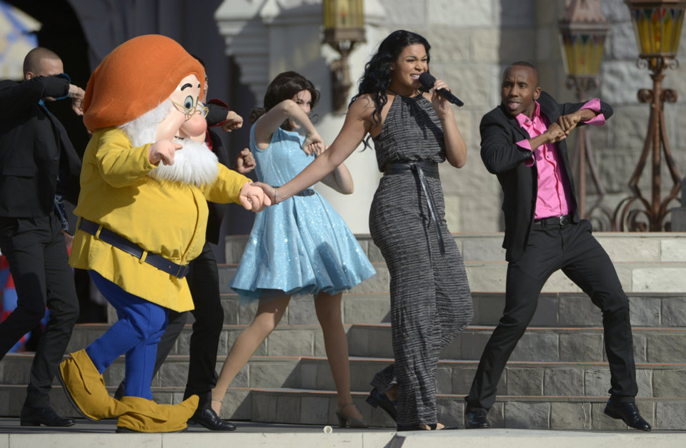 Singer Jordin Sparks, second from right, performs during the grand opening ceremony for the New Fantasyland attraction at the Walt Disney World Resort's Magic Kingdom theme park in Lake Buena Vista, Fla., Thursday, Dec. 6, 2012. The new attraction is the largest expansion at the Magic Kingdom.(AP Photo/Phelan M. Ebenhack)