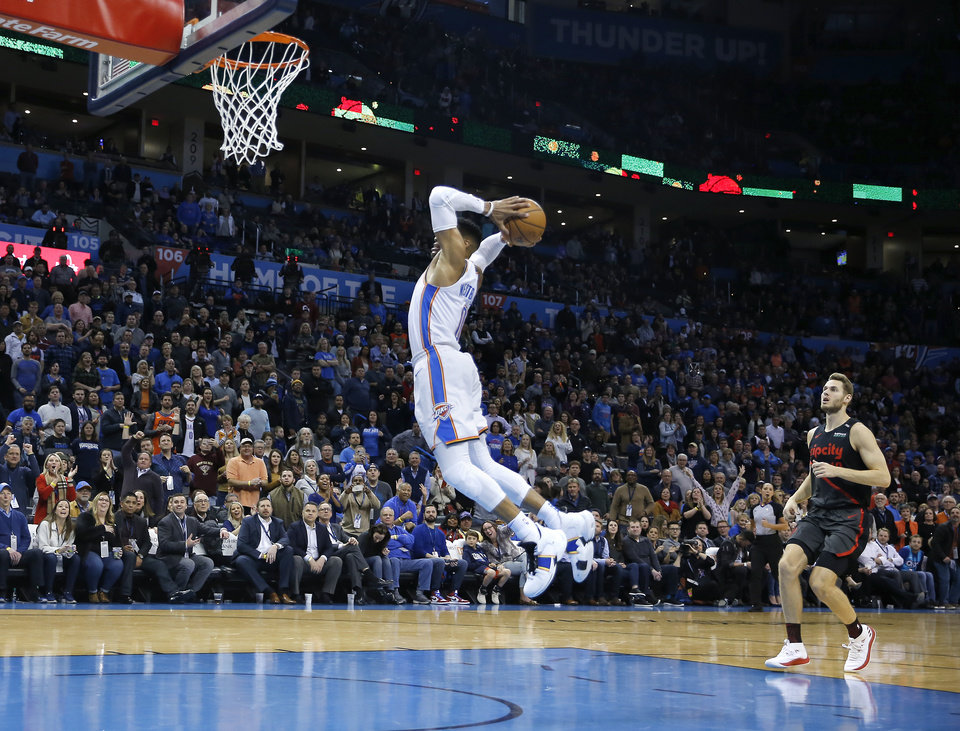 Photo -  Oklahoma City's Russell Westbrook goes up for a dunk in front of Portland's Jake Layman during Tuesday's game at Chesapeake Energy Arena. The Thunder won, 123-114. [Photo by Sarah Phipps, The Oklahoman]