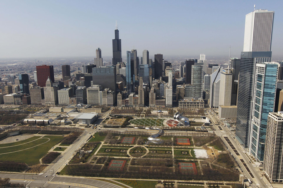Photo -   FILE - This March 16, 2012 file photo shows an aerial view of Grant Park and the downtown Chicago skyline. The Chicago of 2012 is a sparkling, fast-globalizing financial-services center and a cradle for high-tech startups with a vibrant cultural district. However, the city's international reputation largely has remained mired in the past. So it's difficult to overstate the importance of this weekend's NATO summit to business and tourism leaders - or how critical it is for the event to unfold smoothly, despite the potential for large protests. (AP Photo/Pablo Martinez Monsivais, File)