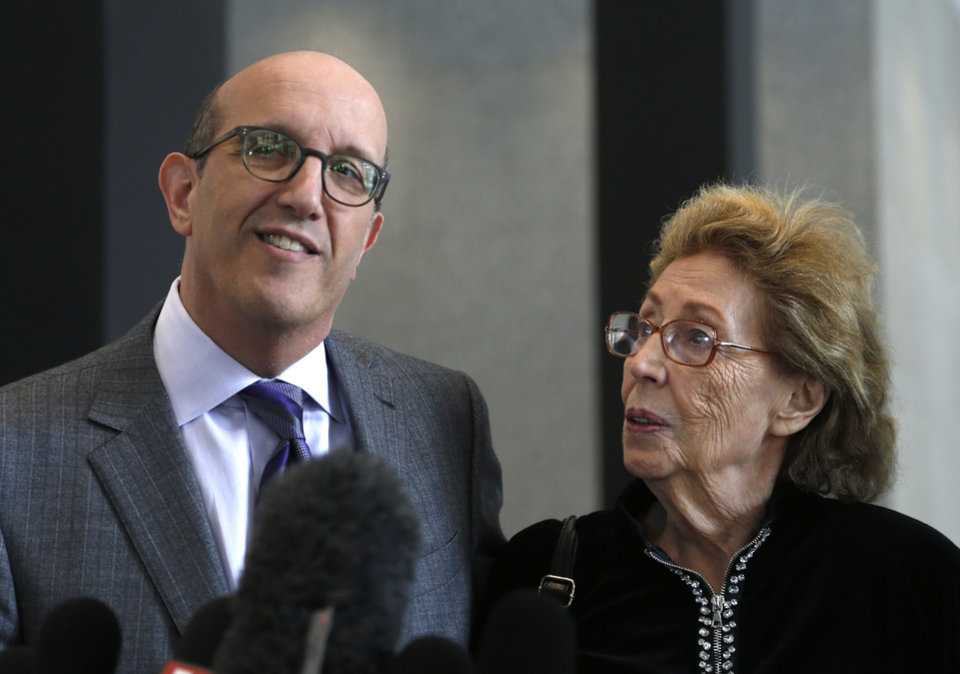 Photo - Attorney Shelly B. Kulwin, left, makes a statement with his client Jacqueline Goldberg, after a federal jury returned with a finding in Donald Trump's favor in her civil case alleging that the real estate mogul cheated her in a skyscraper condo deal, Thursday, May 23, 2013 in Chicago. (AP Photo/Charles Rex Arbogast)