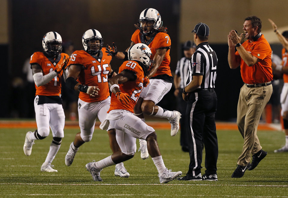 Photo - Oklahoma State celebrates Ramon Richards (7) interception in the final minute of the game during a college football game between the Oklahoma State Cowboys (OSU) and the Pitt Panthers at Boone Pickens Stadium in Stillwater, Okla., Saturday, Sept. 17, 2016. Photo by Sarah Phipps, The Oklahoman