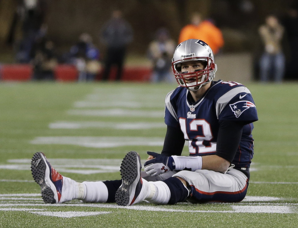 New England Patriots quarterback Tom Brady sits on the field after getting hit during the second half of the NFL football AFC Championship football game against the Baltimore Ravens in Foxborough, Mass., Sunday, Jan. 20, 2013. (AP Photo/Steven Senne)