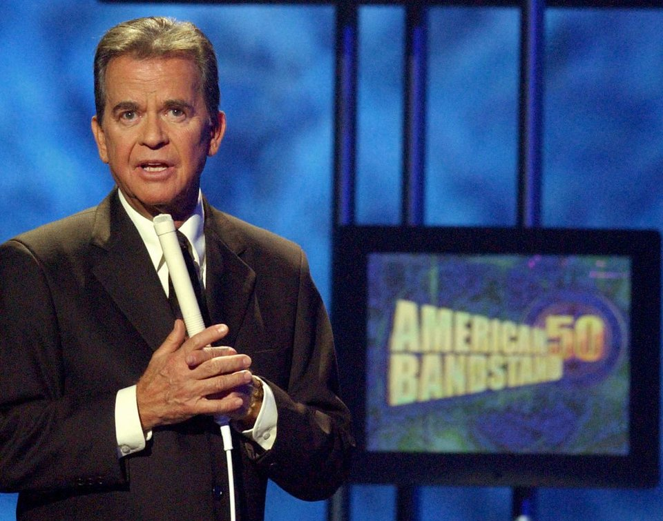 "FILE - In this April 20, 2002 file photo, Dick Clark, host of the American Bandstand television show, introduces entertainer Michael Jackson on stage during taping of the show's 50th anniversary special in Pasadena, Calif. Clark, the television host who helped bring rock `n' roll into the mainstream on ""American Bandstand,"" died Wednesday, April 18, 2012 of a heart attack. He was 82. (AP Photo/Kevork Djansezian, File) ORG XMIT: NYDC210"