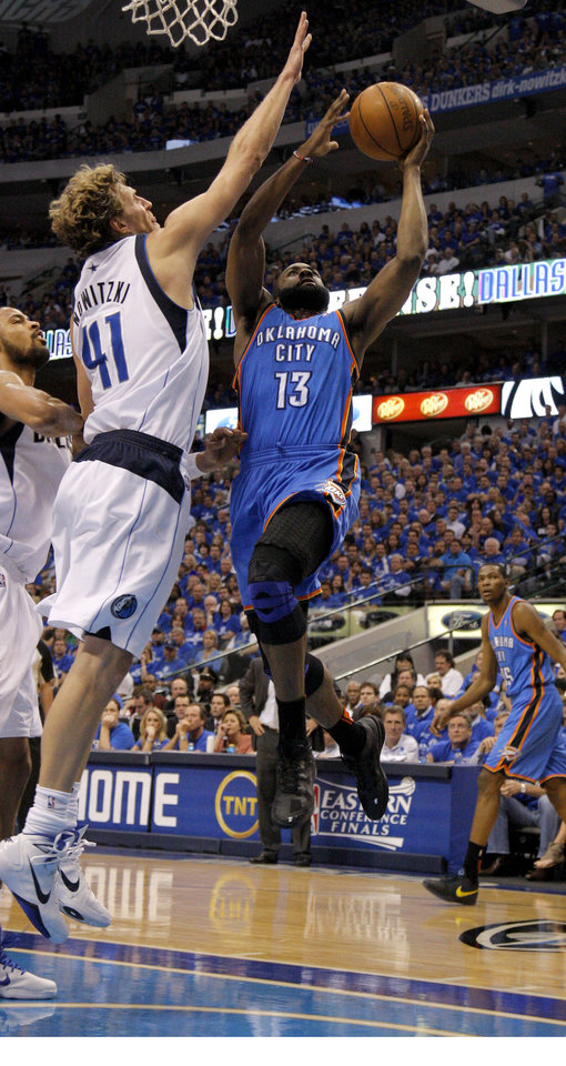 Photo - Oklahoma City's James Harden (13) goes to the basket beside Dirk Nowitzki (41) of Dallas  during game 5 of the Western Conference Finals in the NBA basketball playoffs between the Dallas Mavericks and the Oklahoma City Thunder at American Airlines Center in Dallas, Wednesday, May 25, 2011. Photo by Bryan Terry, The Oklahoman