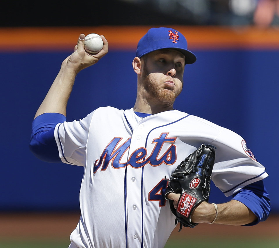 Photo - New York Mets starting pitcher Zack Wheeler throws during the fourth inning of a baseball game against the Atlanta Braves, Sunday, April 20, 2014 in New York. (AP Photo/Seth Wenig)