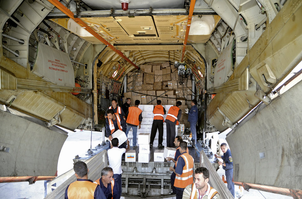 Photo -   In this photo released by the Syrian official news agency SANA, a Russian plane carrying medical aid supplies is unloaded at the international airport in the Syrian capital Damascus on Saturday, October 6, 2012. The Russian government said the medicines and equipment had been approved by the Syrian Health Ministry. (AP Photo/SANA)